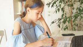 Little girl doing homework at home. stock footage