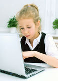 Little girl doing her homework. Royalty Free Stock Image