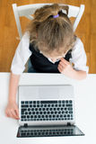Little girl doing her homework at home. Royalty Free Stock Photography
