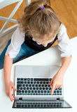 Little girl doing her homework. Royalty Free Stock Photography