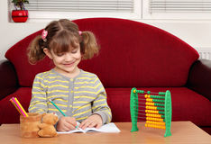 Little girl doing homework Stock Images