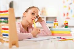 Little girl is doing homework. Stock Images