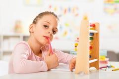 Little girl is doing homework. Royalty Free Stock Photos