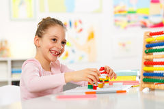 Little girl is doing homework. Stock Photography