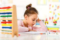 Little girl is doing homework. Royalty Free Stock Photo
