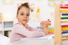 Little girl is doing homework. Royalty Free Stock Images