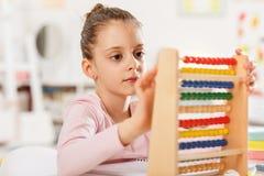 Little girl is doing homework. Stock Photography