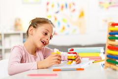 Little girl is doing homework. Royalty Free Stock Photo