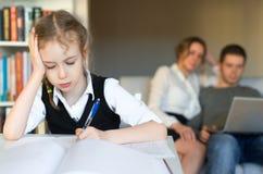 Little girl doing homework. Stock Photos