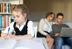 Little girl doing homework. Royalty Free Stock Photo