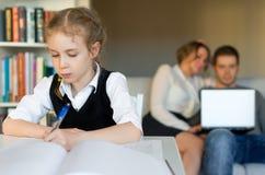 Little girl doing homework. Stock Images
