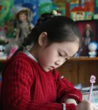 Little girl doing homework at home Royalty Free Stock Photo