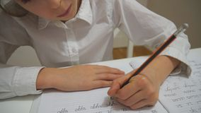 Homework. Little girl is doing homework at home stock footage