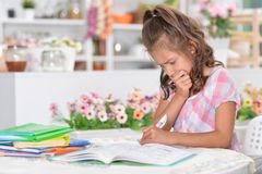 Little girl doing homework. Portrait of a little girl doing homework at home Stock Photography