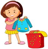 Little girl doing laundry Royalty Free Stock Images