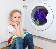 Little girl doing laundry. Royalty Free Stock Photo