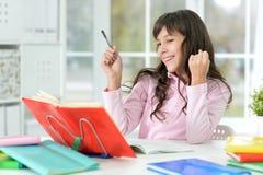 Little girl doing lessons Royalty Free Stock Image