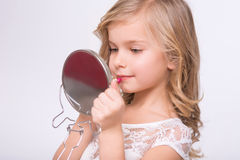 Little girl doing make up Royalty Free Stock Photos