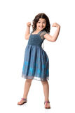 Little girl doing muscle pose Royalty Free Stock Photos