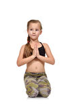 Little girl doing namaste Stock Images