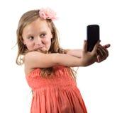 Little girl doing photo of her self Stock Photo