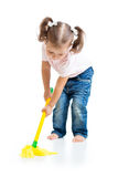 Little girl doing playing and mopping the floor Stock Photos