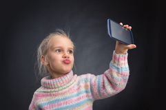 Little girl doing selfie Stock Photo