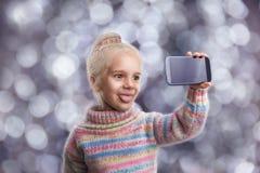 Little girl doing selfie Stock Photography
