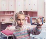 Little girl doing selfie stock photos