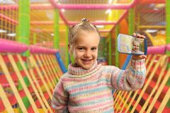 Little girl doing selfie Royalty Free Stock Image