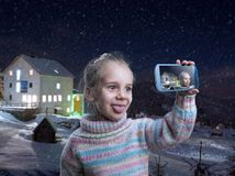Little girl doing selfie Stock Photos