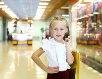 Little girl doing shopping Stock Photography