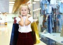 Little girl doing shopping Royalty Free Stock Photos