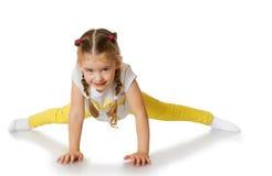 Little girl doing the splits Royalty Free Stock Image