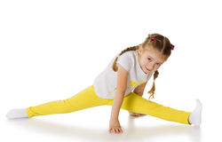 Little girl doing the splits Royalty Free Stock Photography