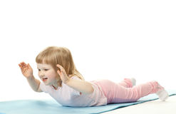 Little girl doing sport exercises Stock Image