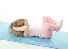 Little girl doing sport exercises Royalty Free Stock Images