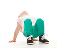 Little girl doing sport exercises. On white background Royalty Free Stock Images