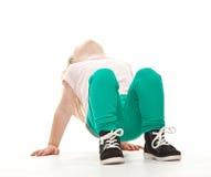 Little girl doing sport exercises Royalty Free Stock Images