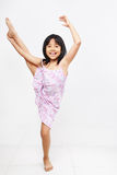 Little girl doing stretching royalty free stock photography