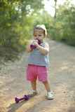 Little girl doing workout with dumbbell. In nature Royalty Free Stock Images