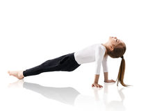 Little girl doing yoga exercises. Over white background Royalty Free Stock Image