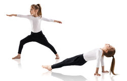 Little girl doing yoga exercises Stock Image