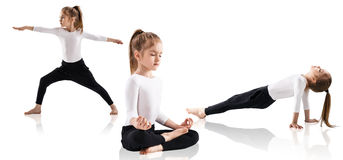 Little girl doing yoga exercises. Over white background Royalty Free Stock Photos