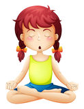 A little girl doing yoga Stock Images