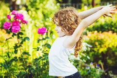 Little girl doing yoga in the summer park. Healthy lifestyles co Royalty Free Stock Images