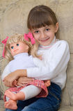 The little girl with a doll Stock Photo