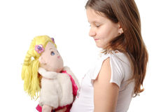 Little girl with a doll Stock Images