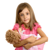 The little girl with a doll. The smiling little girl embraces a doll Royalty Free Stock Images