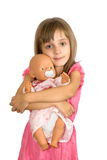 The little girl with a doll. The smiling little girl embraces a doll Stock Photography